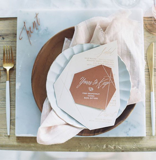 We are OBSESSED with this marble and copper places setting.