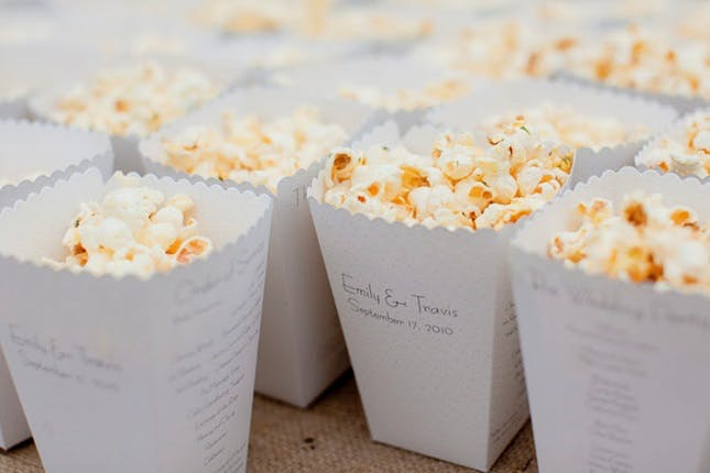 Ditch the boring paper programs for your wedding and give them popcorn! Love this non-traditional and unique wedding program idea.