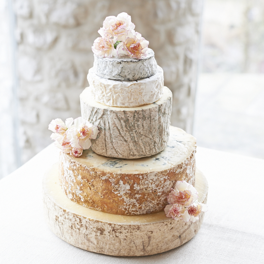 Wowza. This white and bright wedding cake is actually a cheese wheel! Love this non-traditional idea.