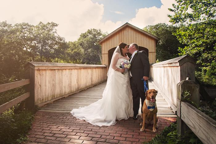 A bride, her groom, and her dog. Beautiful wedding photos.
