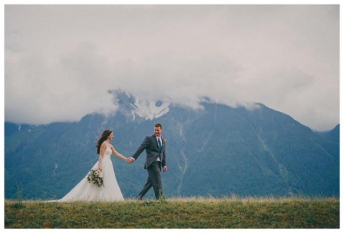 The most stunning first look photos with mountains as the background and deep, natural photography.