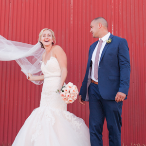 How fun is this couple and their wedding with this red wall?! LOVE!
