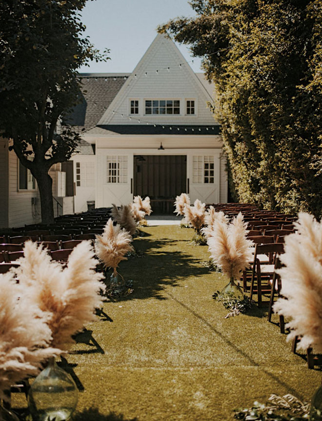 Aisle markers are a great way to add pampas grass.