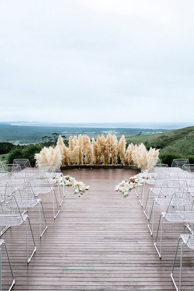 Pampas grass ceremony circles is a trend we hope sticks around.