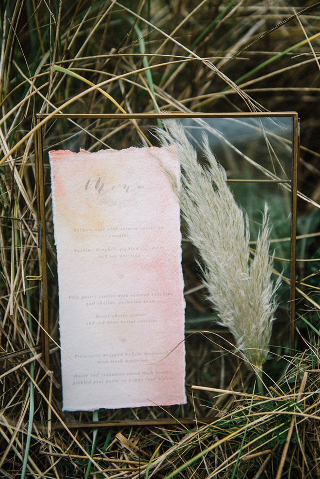 Displaying a menu with pampas grass is a special touch.