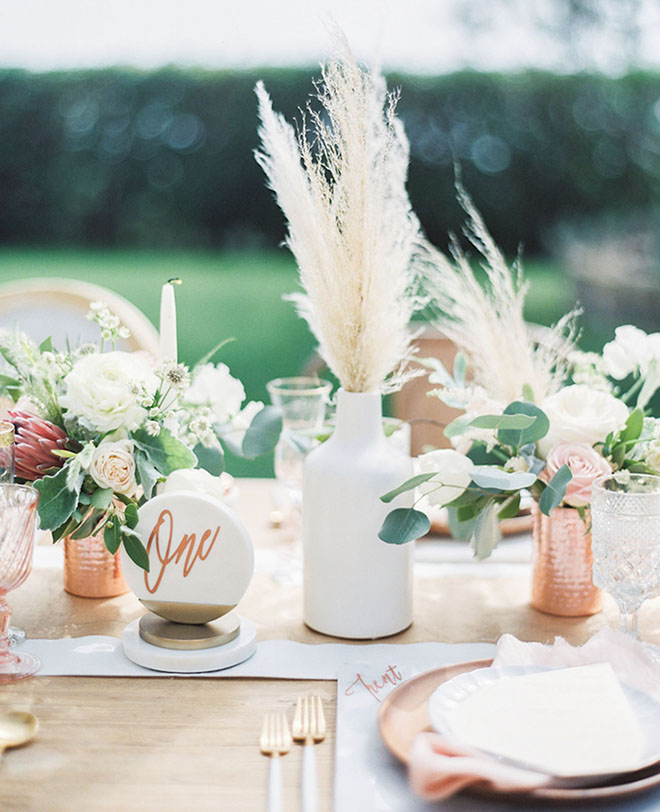 Springs of pampas grass are perfect boho touch to a table.