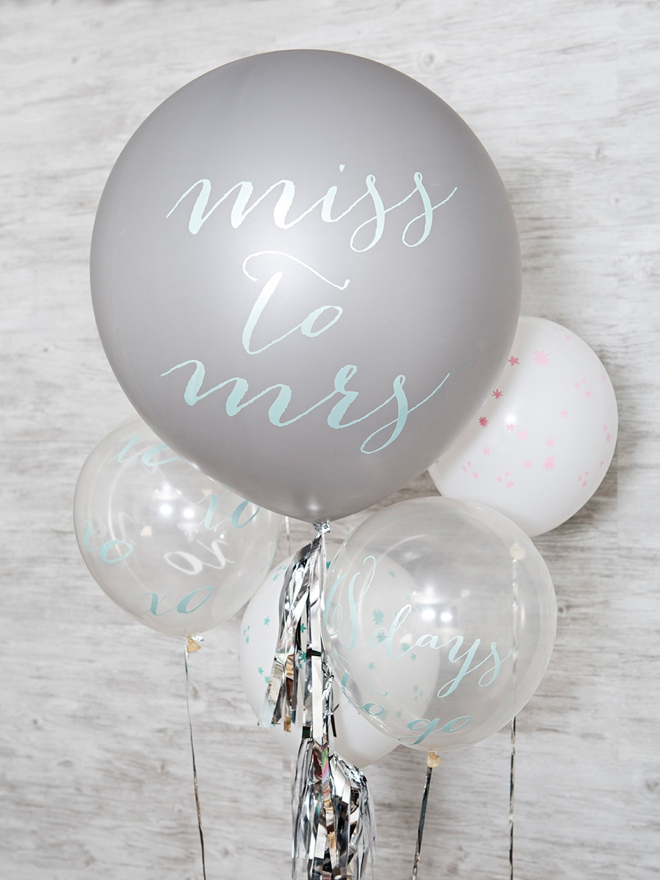 Make your own custom balloon signs using your Cricut and vinyl!