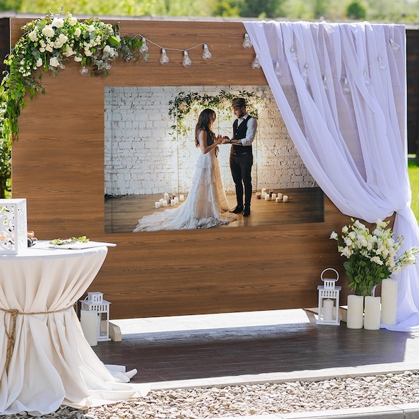 I love this instead of a wedding guest book! Get a custom canvas print made and ask guests to sign it.