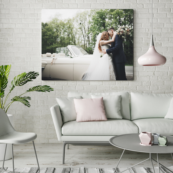 Love this decorating idea! A custom wedding photo canvas hanging above the couch. And it's cheap to order!