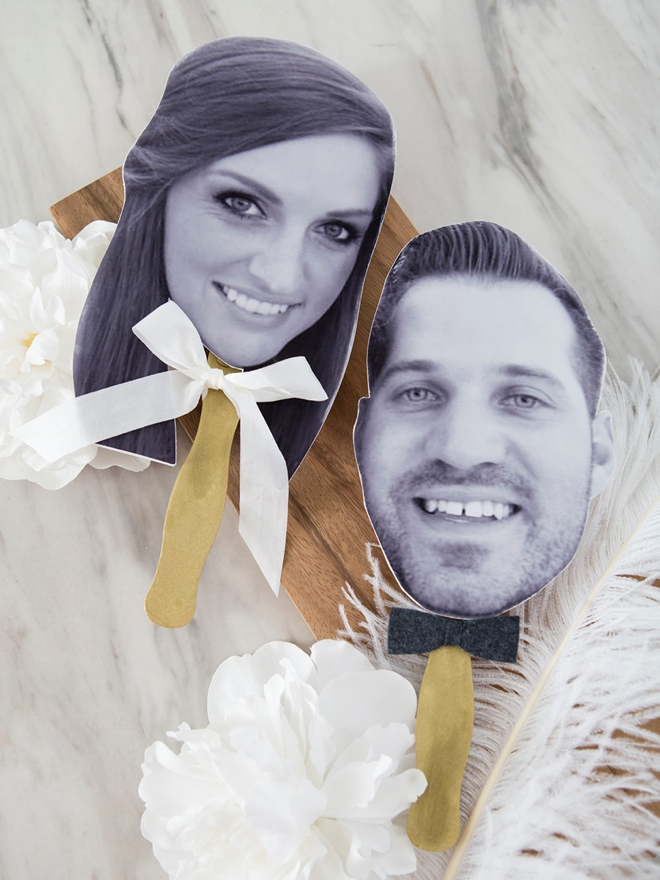 Make photo paddles to use during the wedding shoe game instead of shoes!