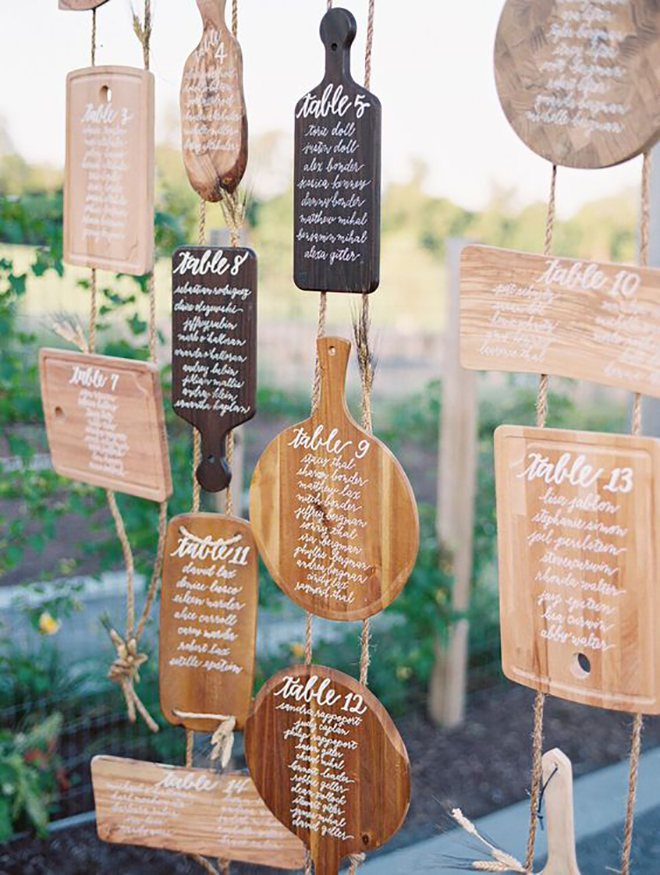 Calligraphied cutting boards make a fabulous seating display
