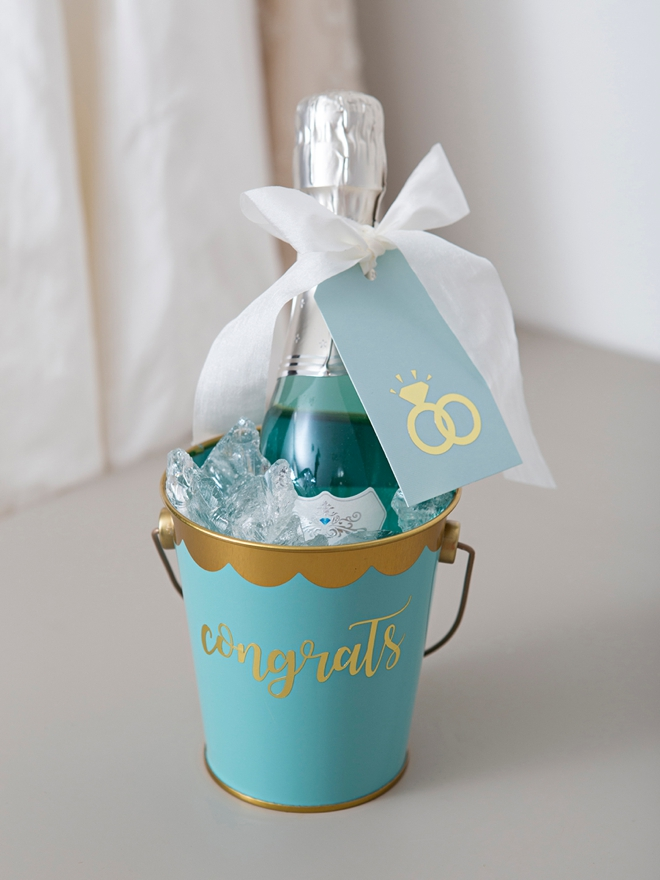 These DIY Mini-Champagne bucket engagement gifts are the best!