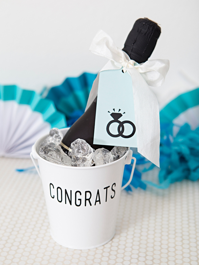 These DIY Mini-Champagne bucket engagement gifts are the cutest!
