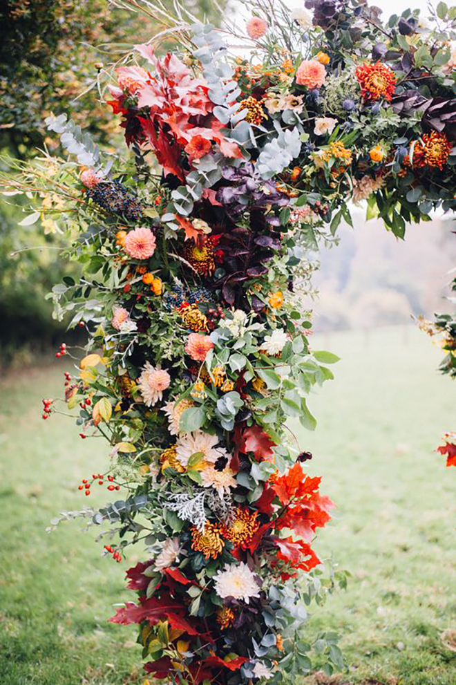 A fall floral arch is an awesome statement piece.