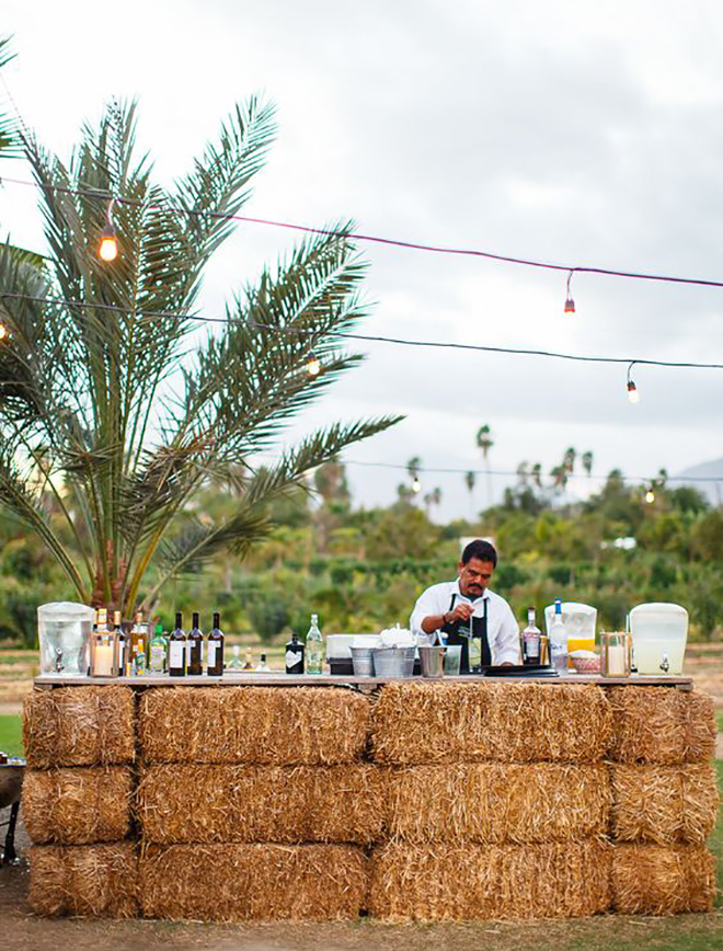 A hay bale bar is such a fun fall wedding idea!