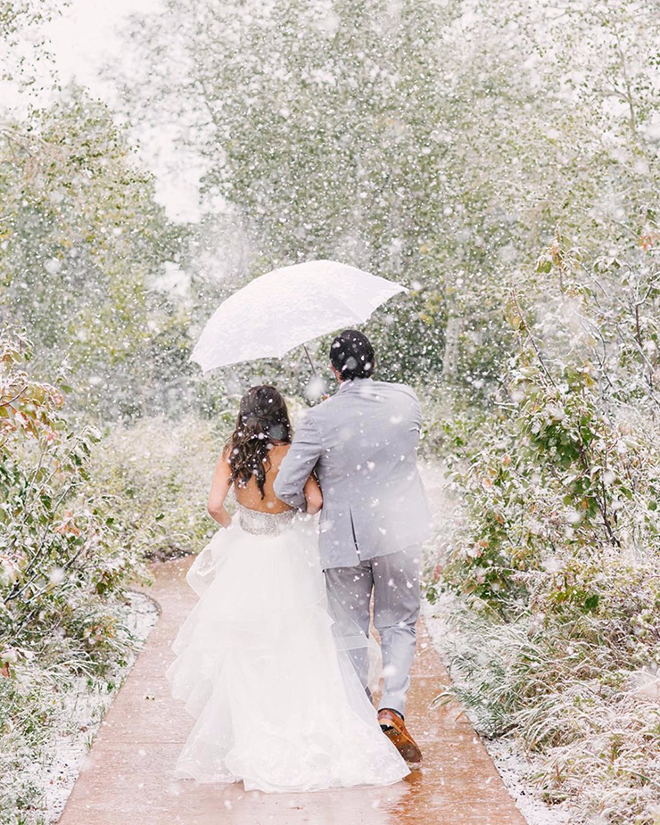 A must have winter wedding shot, snow snap.