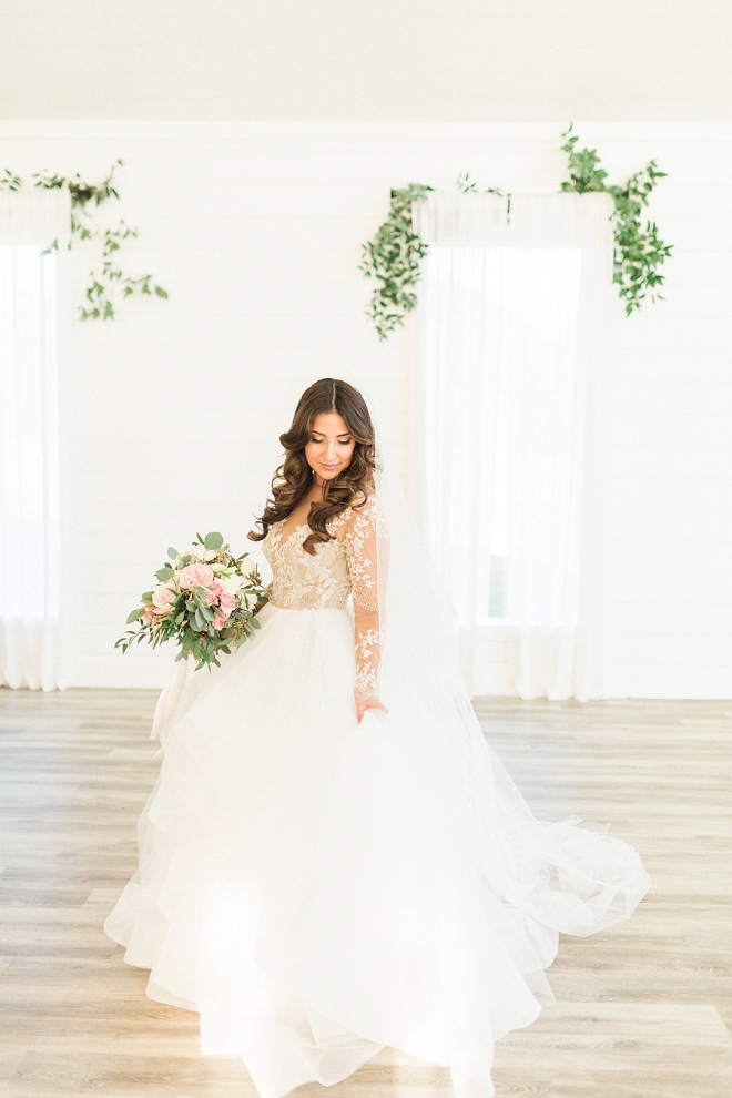 Our Bridal Blogger Brittany's super GORGEOUS farmhouse style wedding was not only amazing, but look at this dress! Super gorgeous + one of our favorites!