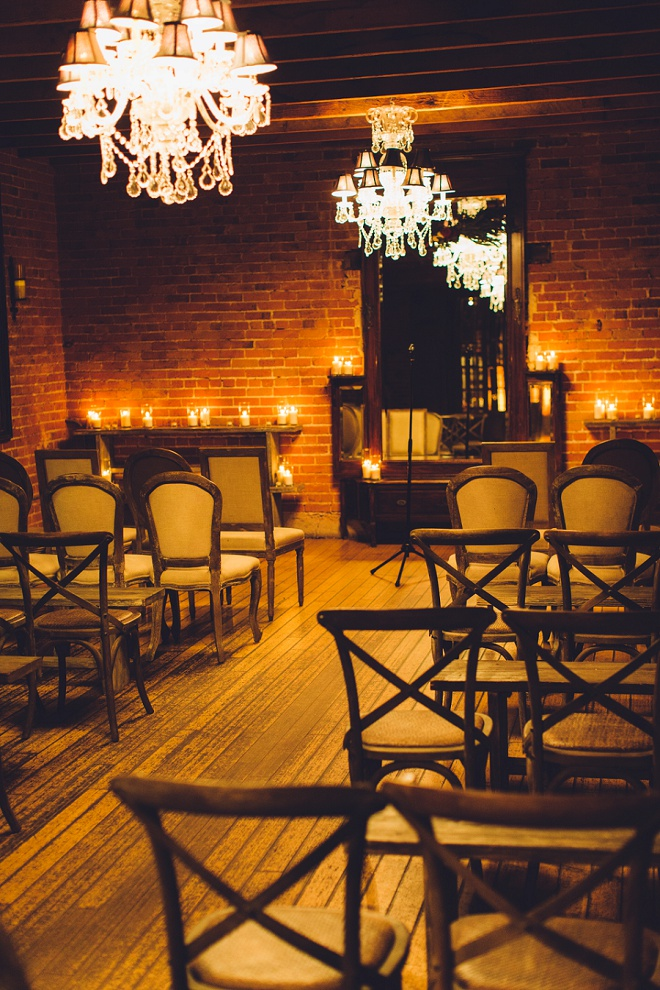 Intimate, candle-lit and chandeliers? Sign us up! We can't get enough of this gorgeous ceremony location or the rest of this dreamy day!