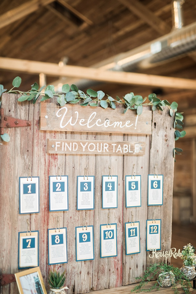 This handmade seating chart is making us swoon with its classic wood + greenery style! Don't miss more from this gorgeous day!