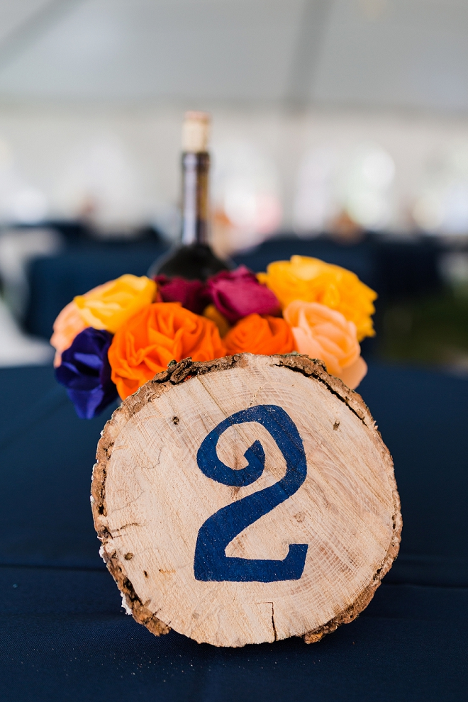 We love how creative these painted wooden table numbers we're at this backyard Missouri wedding! See more from this intimate and handmade wedding!