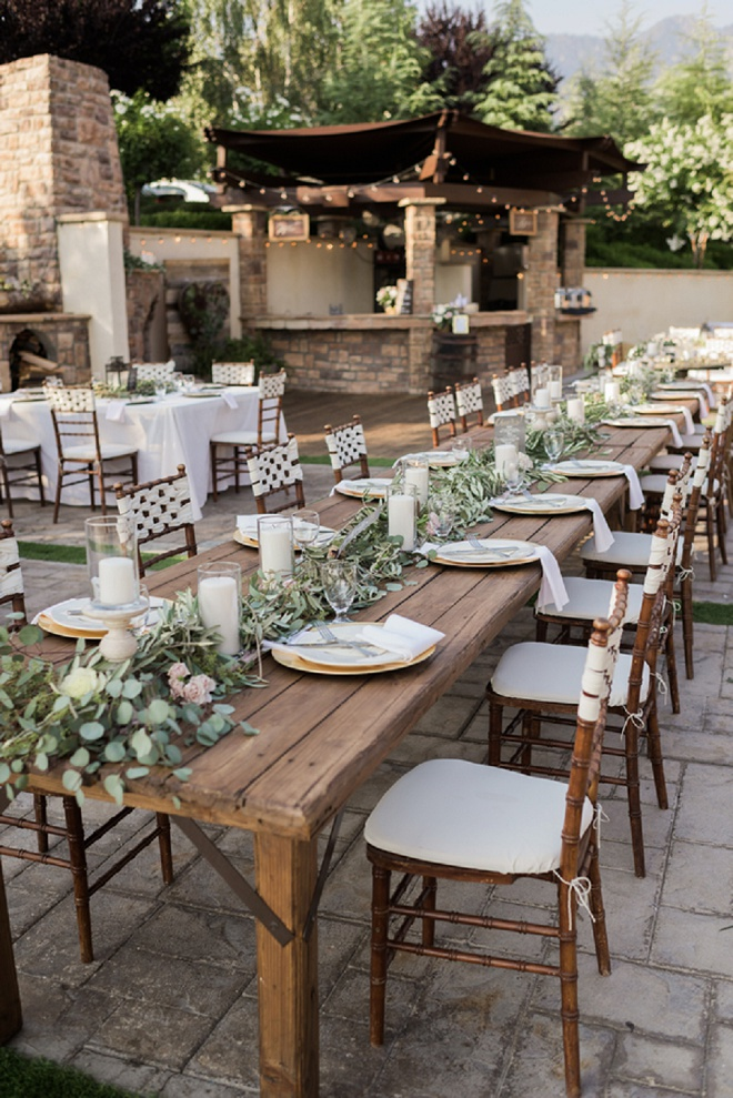 To us there's no better centerpiece than lush greenery, candles and flowers and this wedding had just that! Don't miss more from this gorgeous day!
