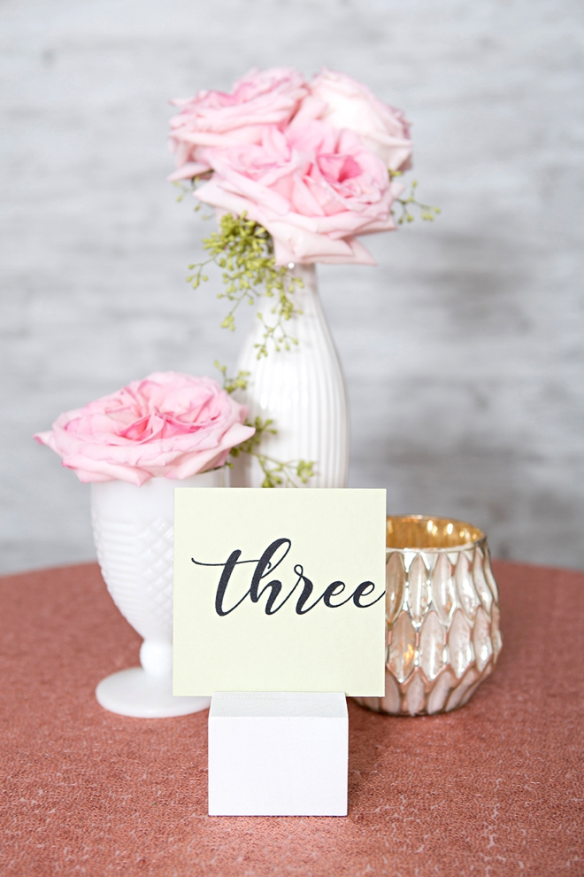 Create your own wood block table number stands and paint them any color!
