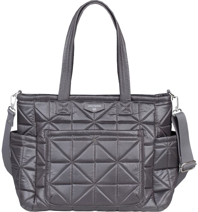 I would NOT guess this is a diaper bag! I love that it's waterproof and quilted. It looks like a purse!