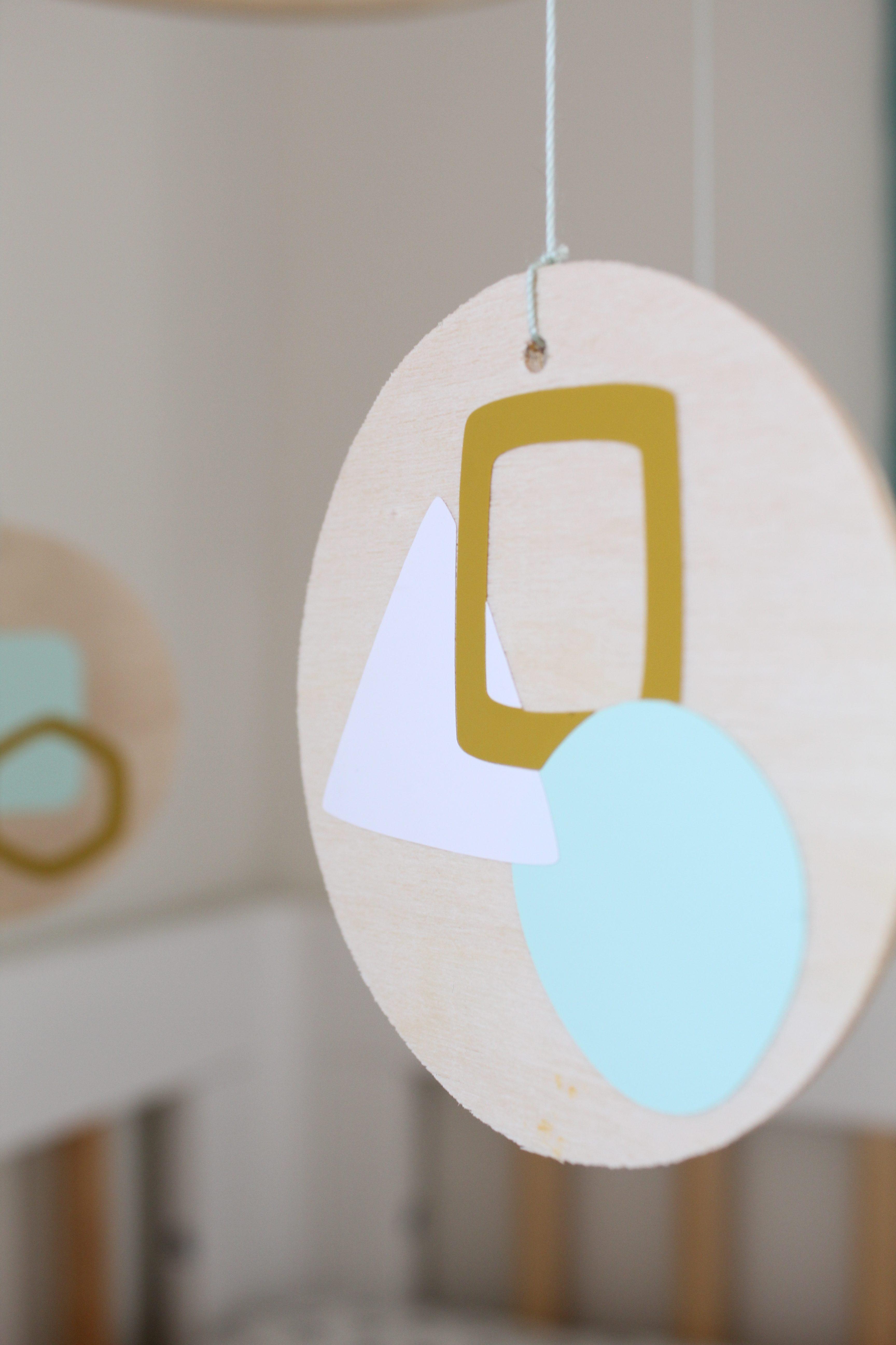 This DIY modern geometric nursery mobile is a must see!