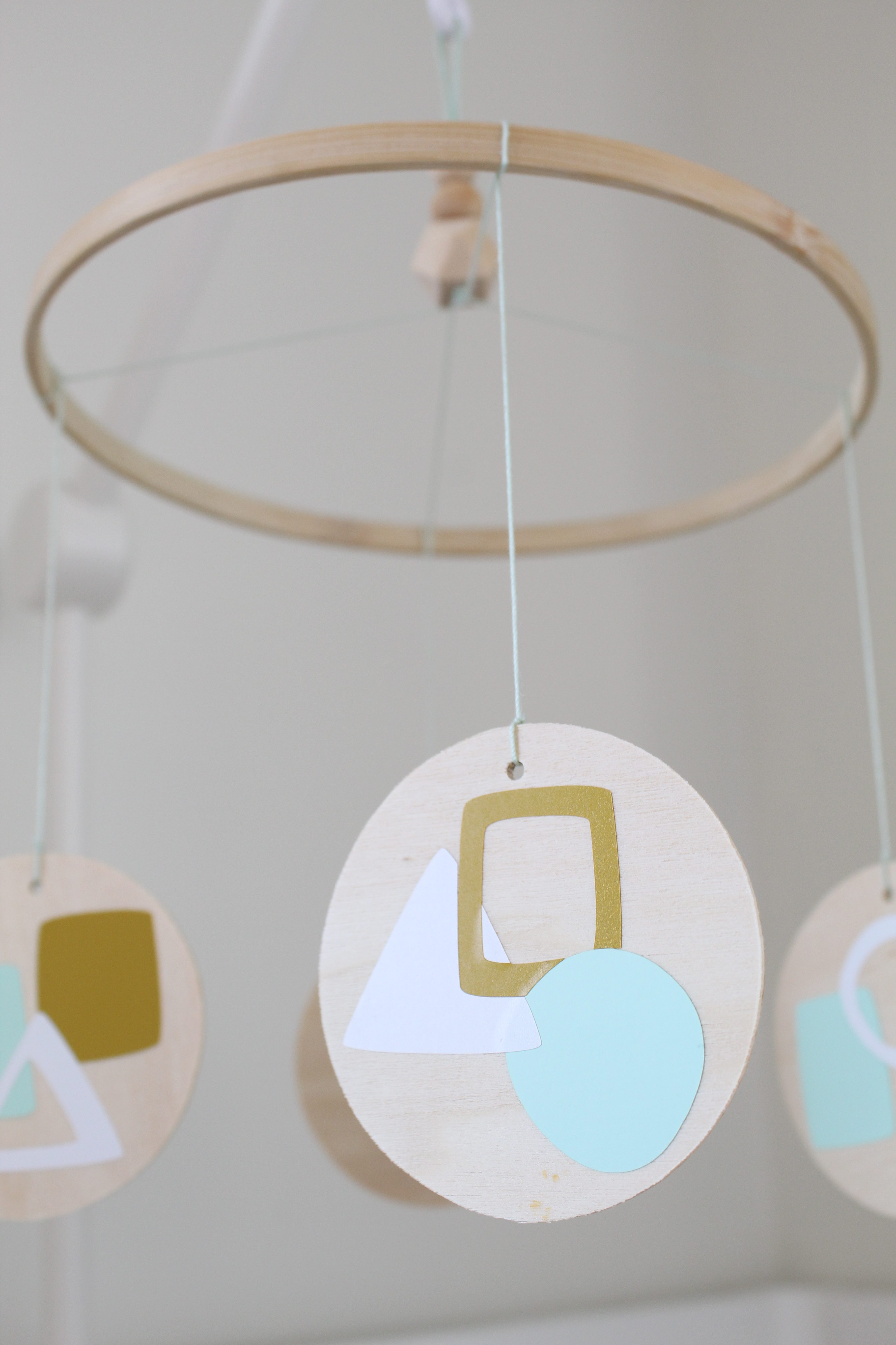 This DIY modern geometric nursery mobile is the perfect mix of form and function to hang over your beloved little one.