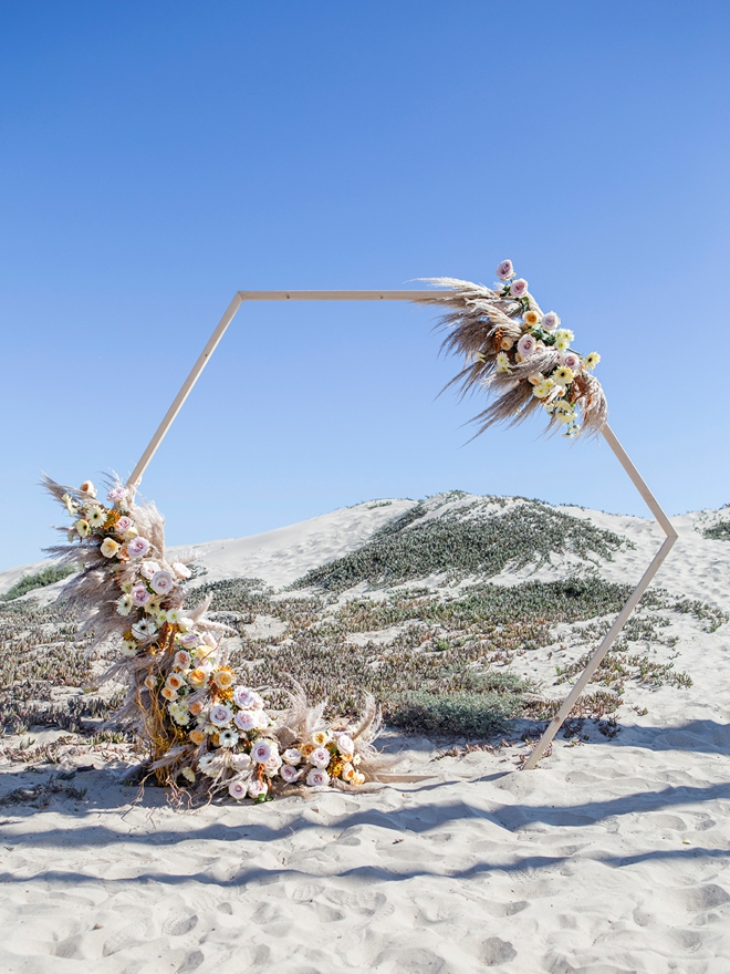 You can DIY this gorgeous hexagon wedding arch yourself, we'll show you how!