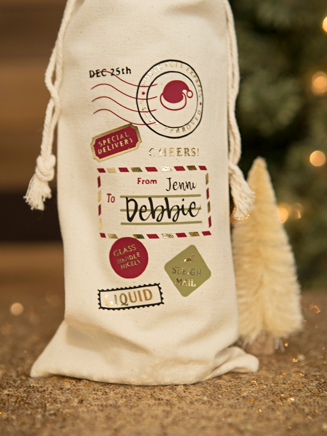 Use your Cricut to make these AMAZING personalized Santa wine bags!