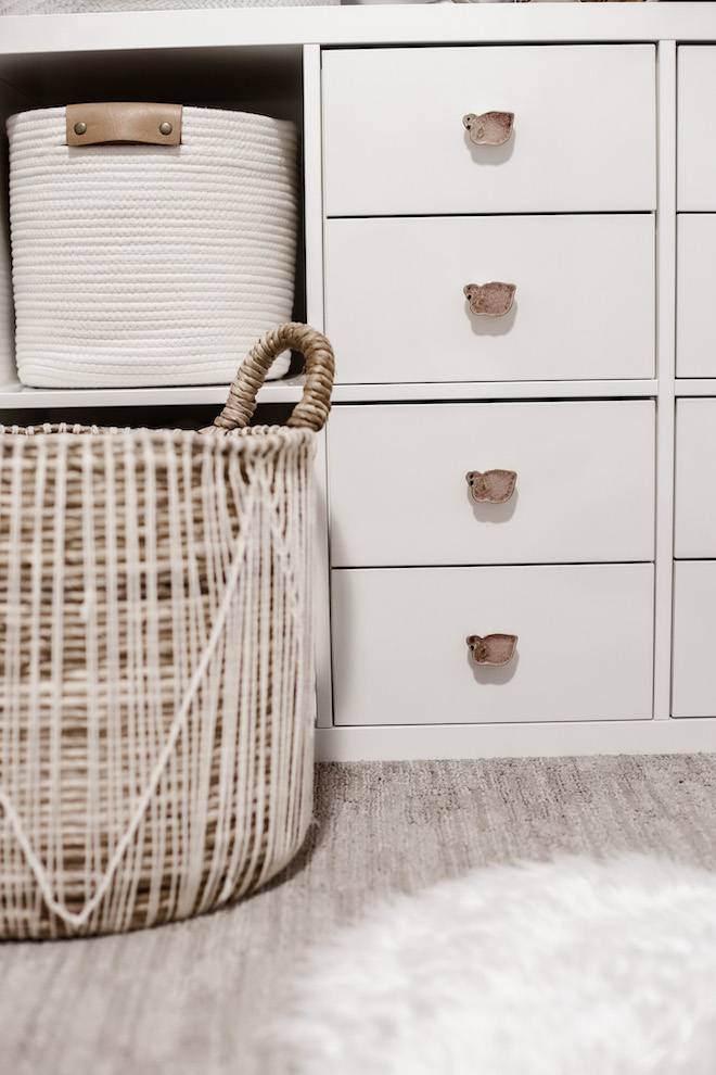 Cute, white nursery details with swans.  Love the boho vibe of this nursery.