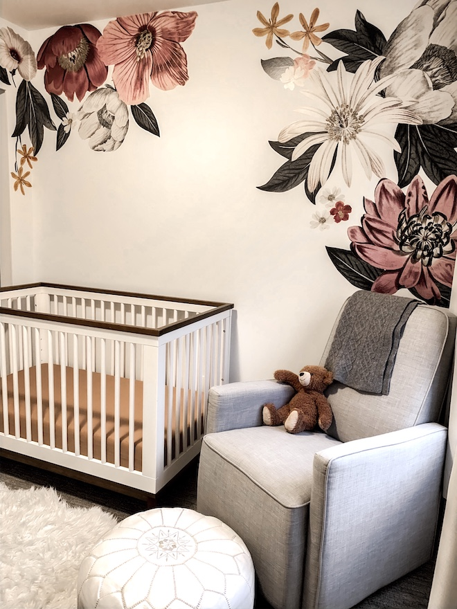 "This baby girl nursery is incredible! I love the minimalist vibes and feminine flowers without being too ""girly""."