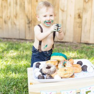 OMG! This donut grow up first birthday photo shoot is the absolute cutest!