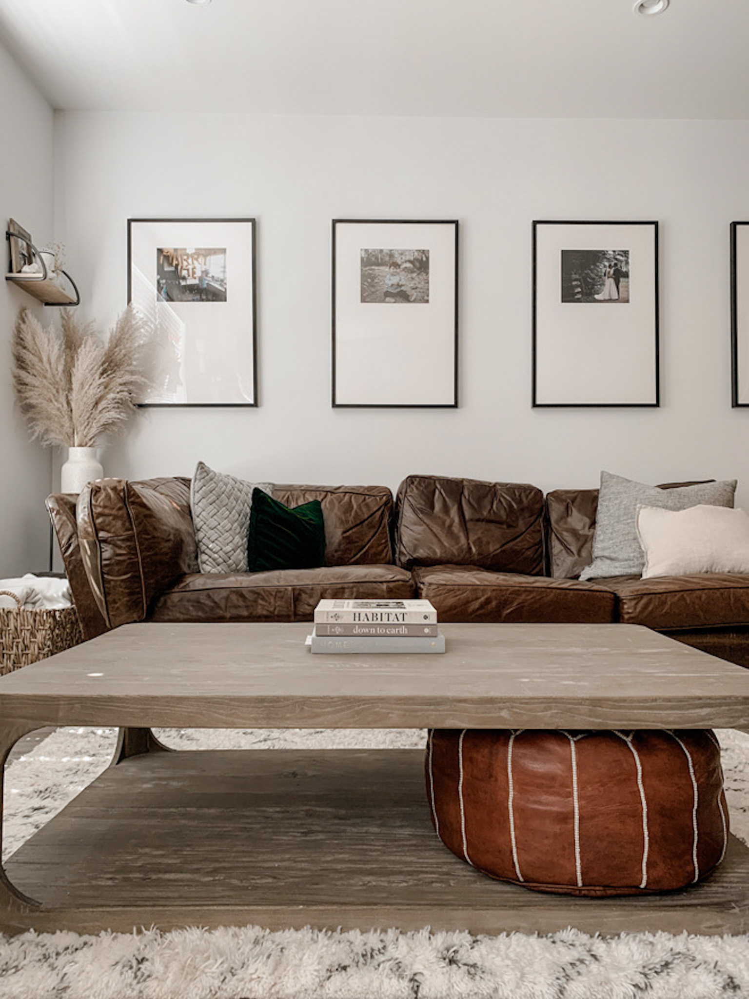 This is the most perfect minimalist, natural living room! The best part is the gallery wall with family photos. Would you believe it's a DIY?! #ikeadiy #diy #gallerywall