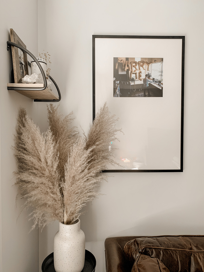Pampas grass and an oversized mat picture frame gallery wall. Pure neutral living room perfection. #diy #homedecor #pampasgrass