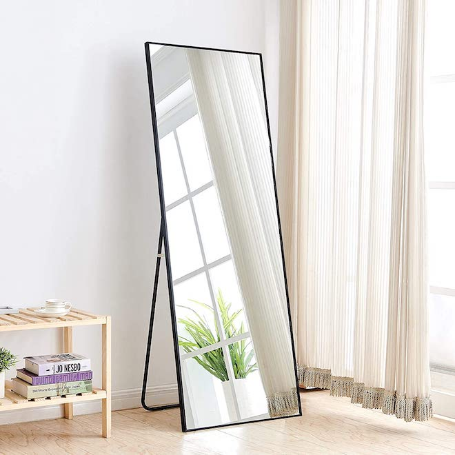 Floor mirrors can get SO expensive SO quick, but this minimalist beauty doesn't! It comes in a variety of sizes and can be mounted on the wall or it can stand alone on the floor. I love a decor piece that does double duty! #mirror #minimalist #design #fulllength #blackmirror