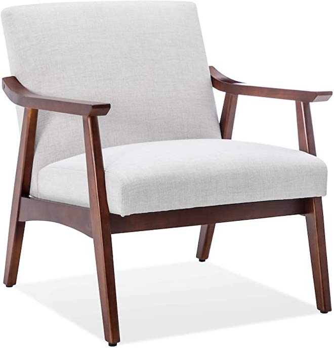 "This chair is actually a West Elm copycat (if you want to look it up, search ""Mid-Century Show Wood Chair""). West Elm's version is $700 and looks so similar. #copycat #dupe #lookalike #amazon #mcm"