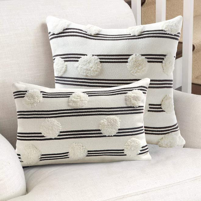 Swapping out your pillows is an easy and affordable way to breathe new life into a space. These tufted, striped pillow covers are less than $20 each and will add boho vibes to any space. #pillows #throw #amazonfinds #amazon #decor #homedecor #inspo
