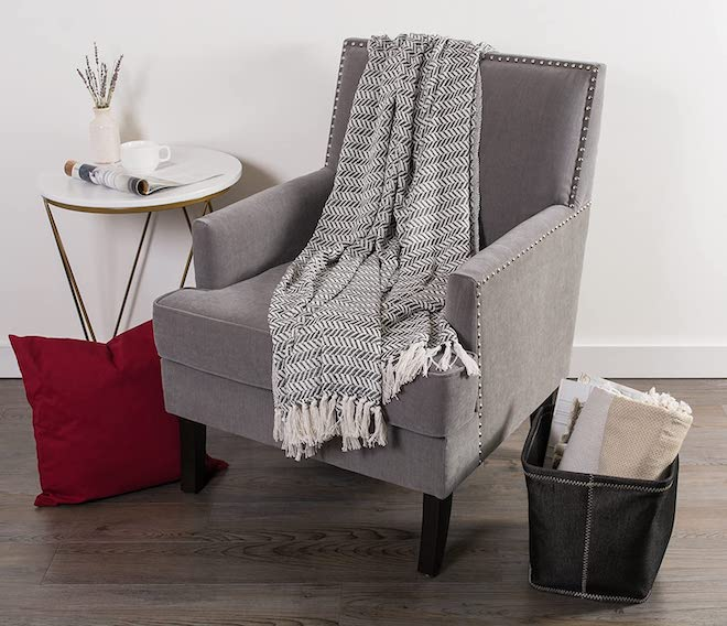 This herringbone blanket is $16 and comes in red, blue, and gray. It's also 100% cotton and machine washable, which is a must in my house. #amazon #throw #blanket #cozy #couch