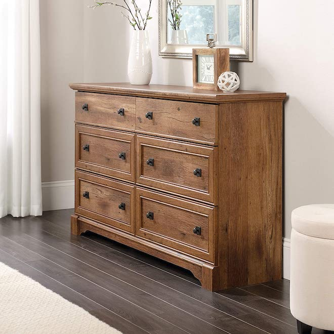 This dresser caught my eye because the finish and drawer pulls reminded me of Pottery Barn. The price was a close second; it's hard to find a good dresser under $500, nevermind under $300! #bedroom #furniture #dresser #oak #affordable #amazon