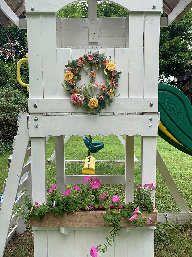 This charming DIY peace wreath makes this play set makeover extra special!