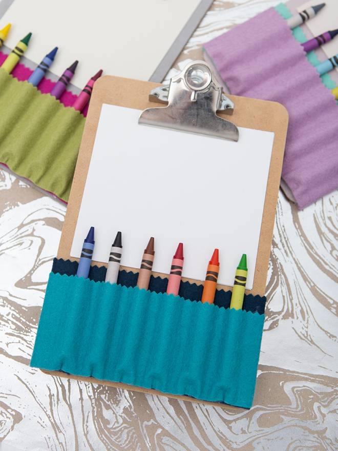 These DIY felt crayon holders for clipboards are SO cute!