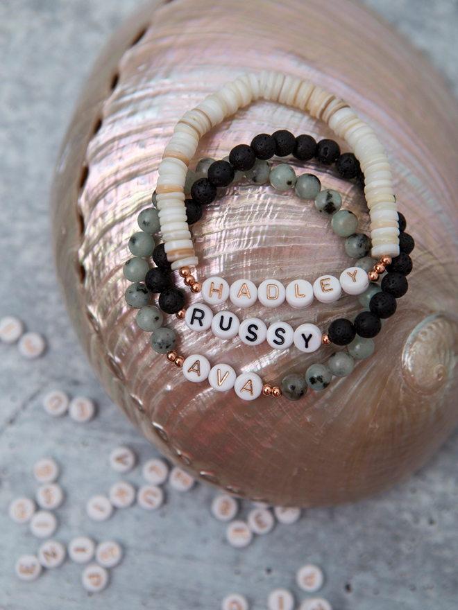 This detailed video tells you exactly how to make beaded name bracelets!
