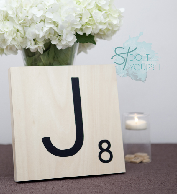 Looking for a cute and playful table number idea? These DIY giant scrabble tile table numbers are perfect and easy to do yourself!