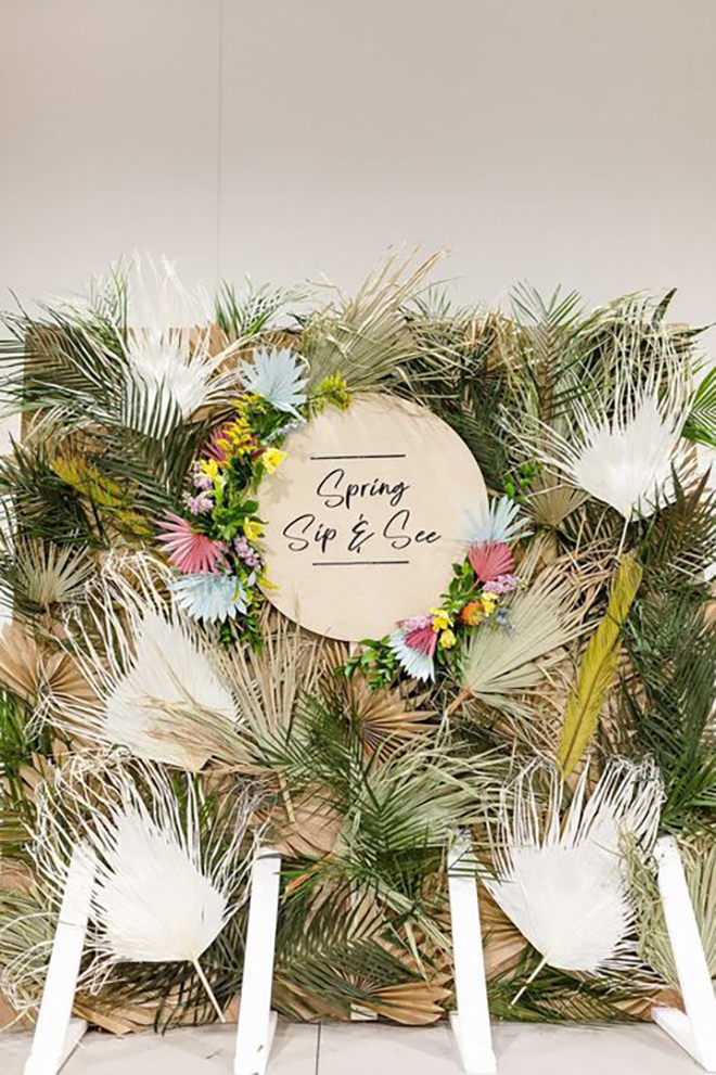 This dried green backdrop was made with paper palm fronds!